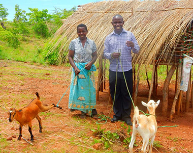 Change Her World couple with goats in Malawi
